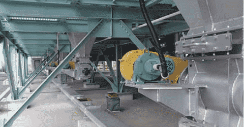 Conveyor under dust collector