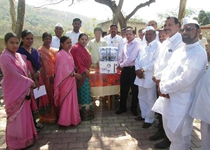 School personnel and local residents receiving a purifier