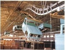 Ceiling-mounted conveyor for automobile plants