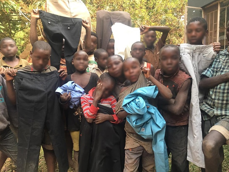 A photo of children receiving work clothing safely